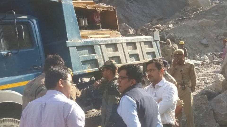 Border Roads Organisation officials working to clear the debris from Badrinath road.