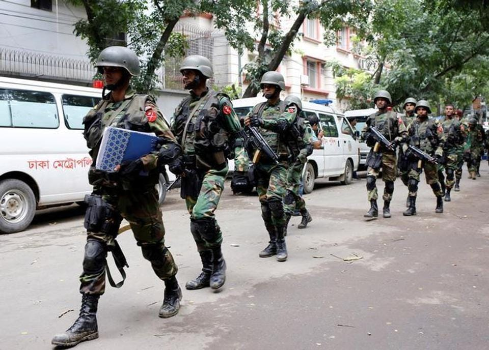 Officials smashed locks to enter the office of former Prime Minister Khaleda Zia.