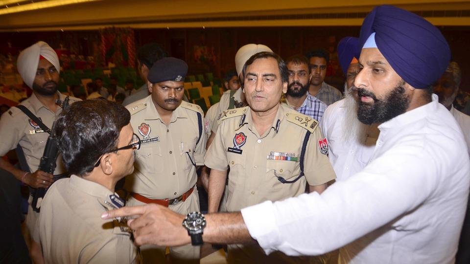 Former Akali minister and Majitha MLA Bikram Singh Majithia  confronts ADGP Law & Order Rohit Chaudhary during a police public meeting in Majitha town on Saturday.