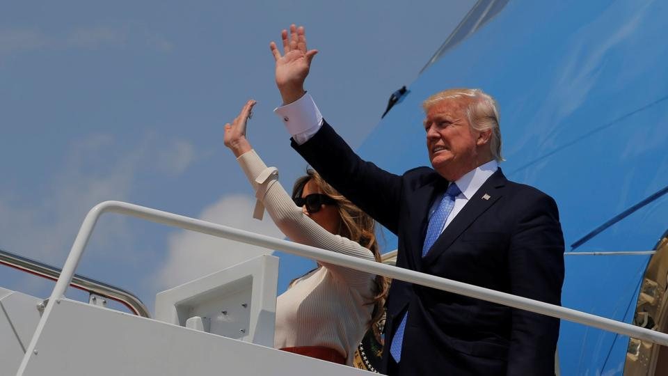 US President Donald Trump and first lady Melania Trump board Air Force One for his first international trip as president, including stops in Saudi Arabia, Israel, the Vatican, Brussels and at the G7 summit in Sicily, from Joint Base Andrews, Maryland on May 19.