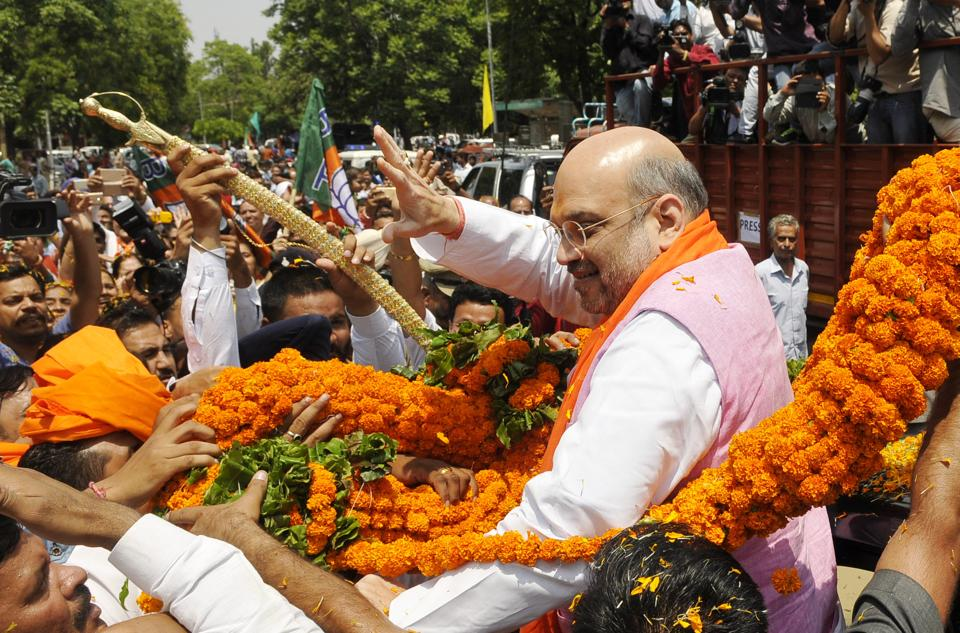 BJP chief Amit Shah greeting supporters during his road show at sector 47 Chandigarh on Saturday.