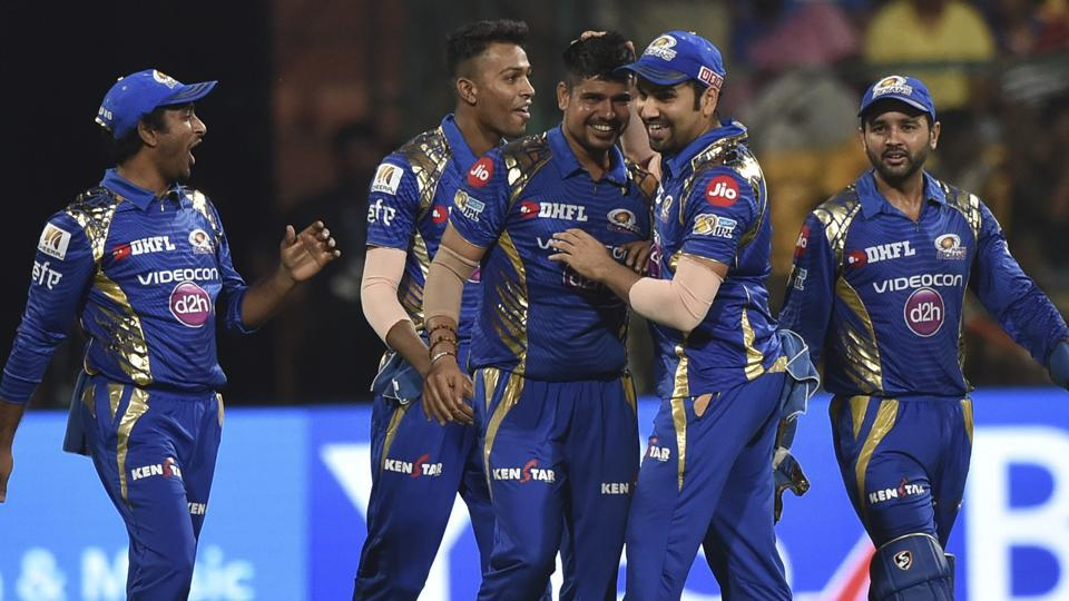 Mumbai Indians' Karn Sharma (R) celebrates a Kolkata Knight Riders wicket with teammates during their 2017 Indian Premier League (IPL) second qualifier match at the M. Chinnaswamy Stadium in Bangalore on Friday.