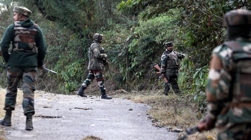 Indian army soldiers take position during an encounter with suspected militants.