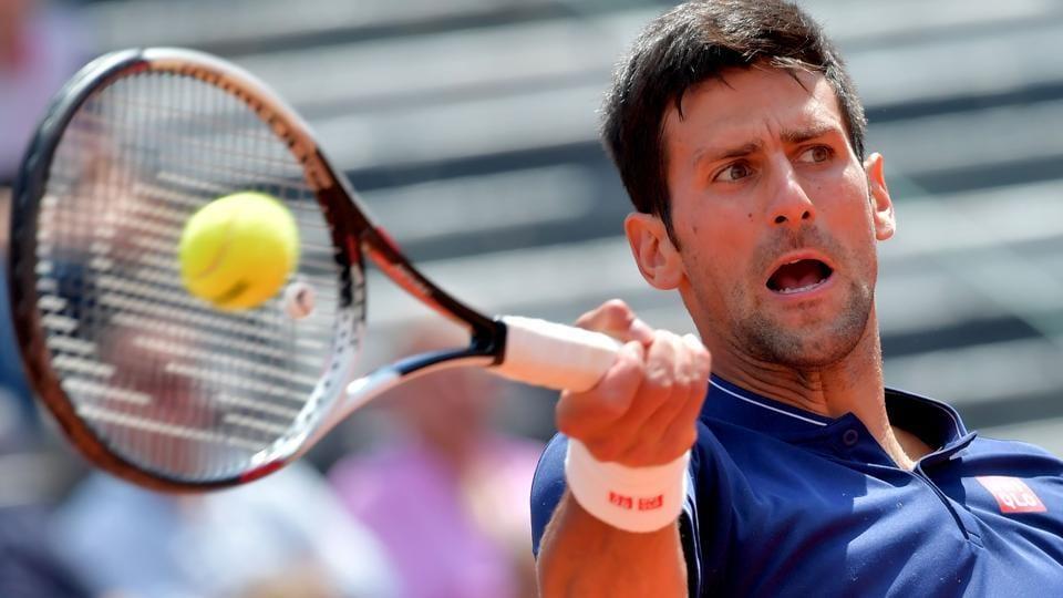 Novak Djokovic hits a return to Juan Martin Del Potro at the Italian Open.