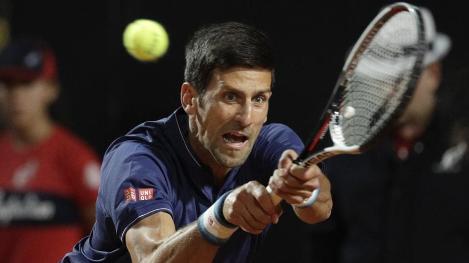 Serbia's Novak Djokovic returns the ball to Argentina's Juan Martín del Potro during their quarter-final match at the Italian Open in Rome on Friday.