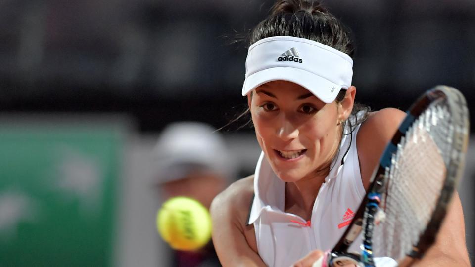 Garbine Muguruza returns the ball to Venus Williams the WTA Italian Open tournament in Rome.