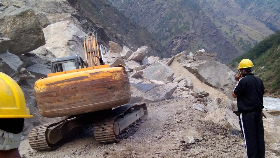 Officials raced to clear the boulders from the stretch leading to Badrinath, which has now been blocked due to Friday's landslide.