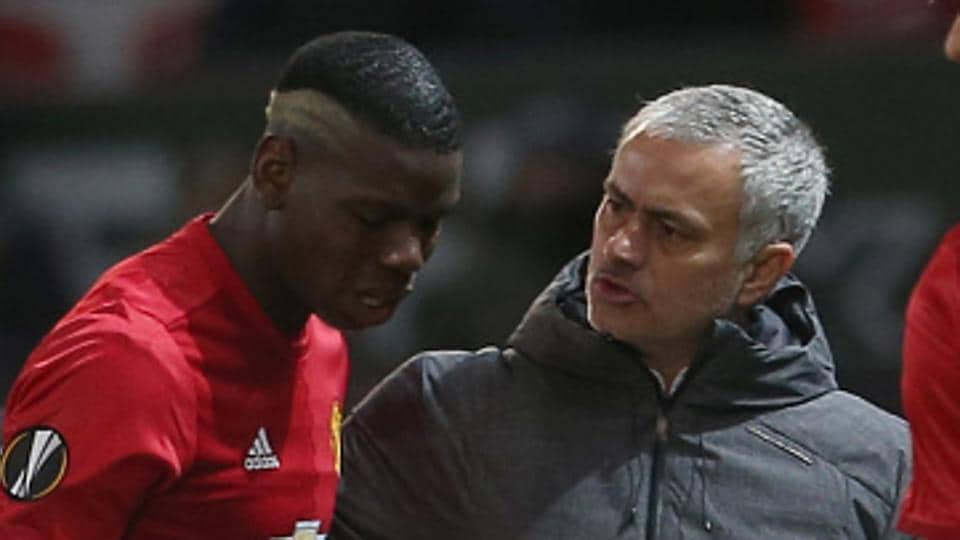 Manchester United manager Jose Mourinho (R) has praised Paul Pogba (L) for the way he has responded to his father's death.