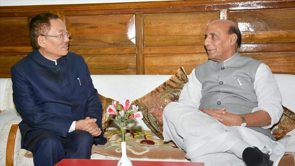 Chief Minister of Sikkim, Pawan Kumar Chamling meeting the Union Home Minister, Rajnath Singh in Gangtok, Sikkim on Friday.