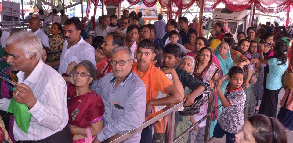 Pilgrims waiting for their turn at a photometric registration counter  at Uttarakhand's Rishikesh .