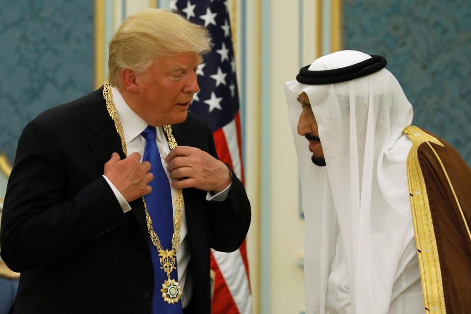 Saudi Arabia's King Salman bin Abdulaziz Al Saud presents Donald Trump with the Collar of Abdulaziz Al Saud Medal at the Royal Court in Riyadh.