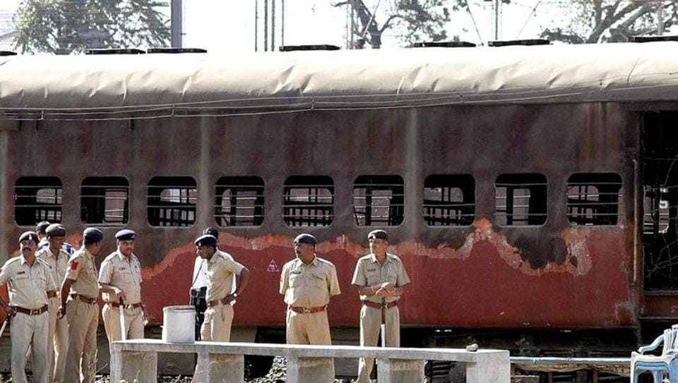 Cops stand guard in front of Sabarmati Express at Godhra station.