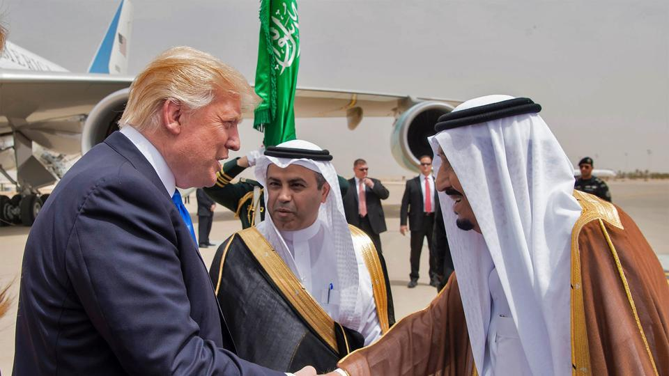 US President Donald Trump (L) shakes hands with Saudi King Salman bin Abdulaziz al-Saud (R) upon arrival at King Khalid International Airport in Riyadh on May 20, 2017.