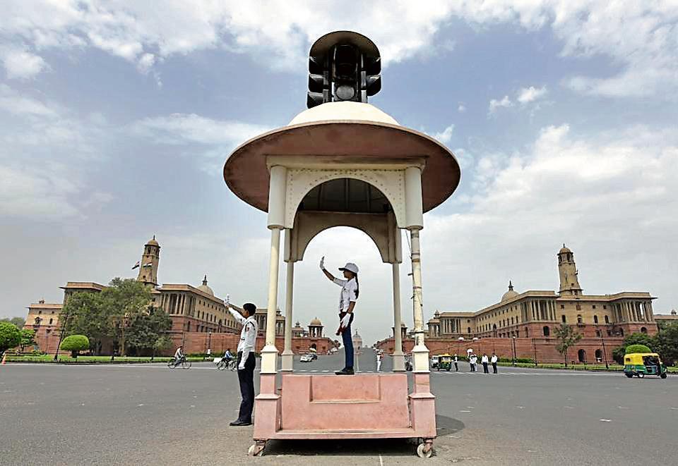 School student managing traffic at Vijay Chowk in New Delhi on Saturday.