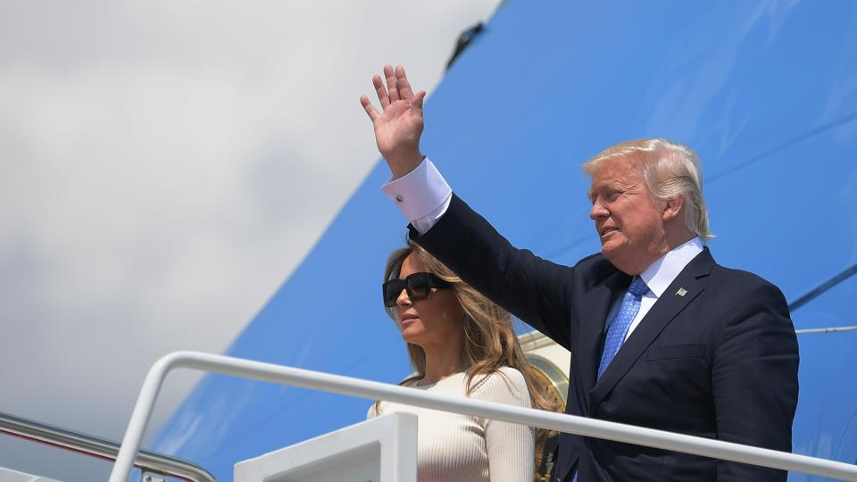 US President Donald Trump and First Lady Melania Trump make their way to board Air Force One before departing from Andrews Air Force Base in Maryland on May 19.