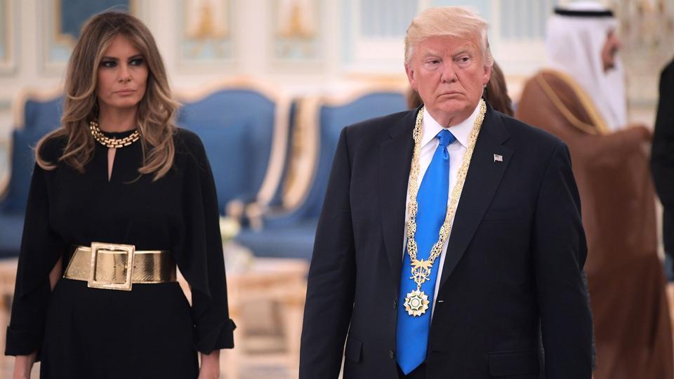 US President Donald Trump and First Lady Melania Trump make their way to a luncheon after Trump received the Order of Abdulaziz al-Saud medal from Saudi Arabia's King Salman bin Abdulaziz al-Saud at the Saudi Royal Court in Riyadh on May 20, 2017.