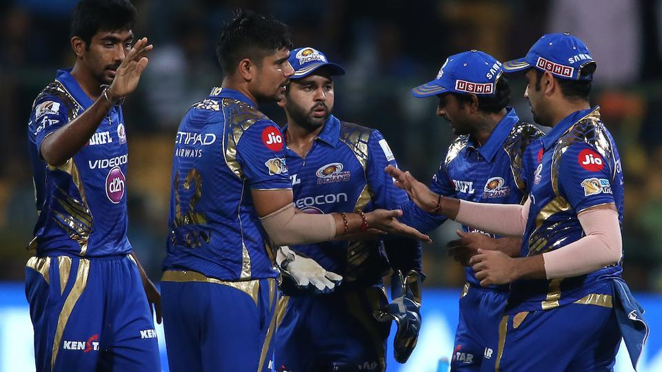Karn Sharma of the Mumbai Indians is congratulated by Mumbai Indians captain Rohit Sharma for dismissing Sunil Narine. (BCCI)