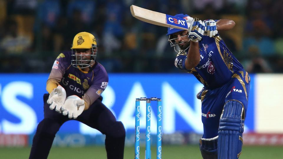 Mumbai Indians captain Rohit Sharma drives a delivery through the covers to the boundary. (BCCI)
