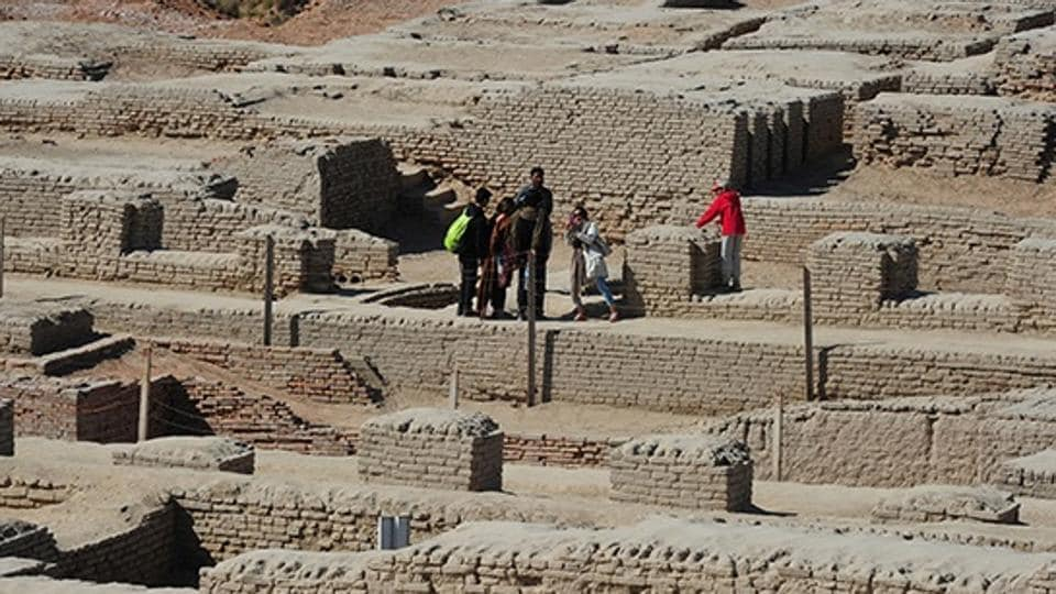 Visitors walk through the UNESCO World Heritage archaeological site of Mohenjo Daro some 425 km north of the Pakistani city of Karachi.
