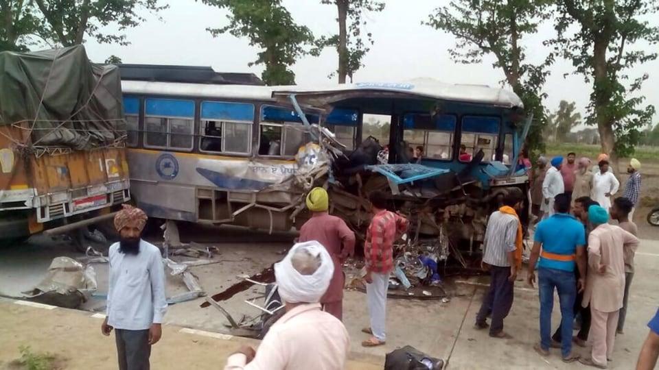 Damaged PRTC bus and truck near Rampura Phul on Sunday.