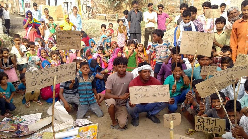 Over 40 Dalit families of Keshopur-Jafri village in UP immersed idols of Hindu deities and threatened to convert to Islam to protest 'biased' police action after caste clashes with Thakurs.