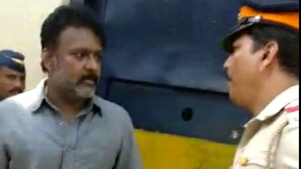 A video grab showing former MLA from Solapur, Ramesh Kadam arguing with assistant police inspector Manoj Pawar outside Byculla jail.