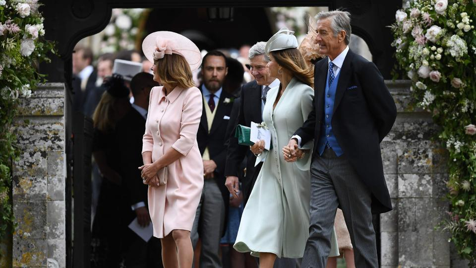 Carole Middleton (L), and her husband Michael Middleton (3R) at St Mark's Church in Englefield. (Justin TALLIS / AFP)