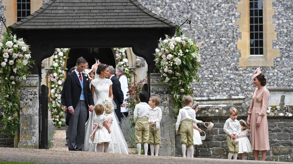 "Pippa wore a lace-encrusted creation from British designer Giles Deacon, who said in a statement issued by Middleton's publicist, Jo Milloy, that he was ""thrilled"" to work with Pippa on her wedding dress. (Justin TALLIS / AFP)"