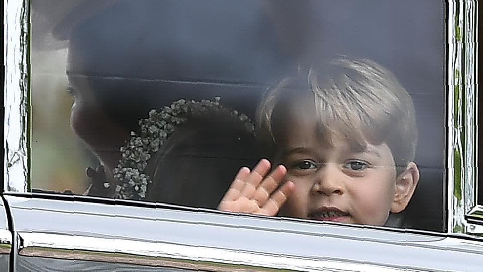 Britain's Prince George waves as he leaves in a car after attending the wedding. (Justin TALLIS / AFP)