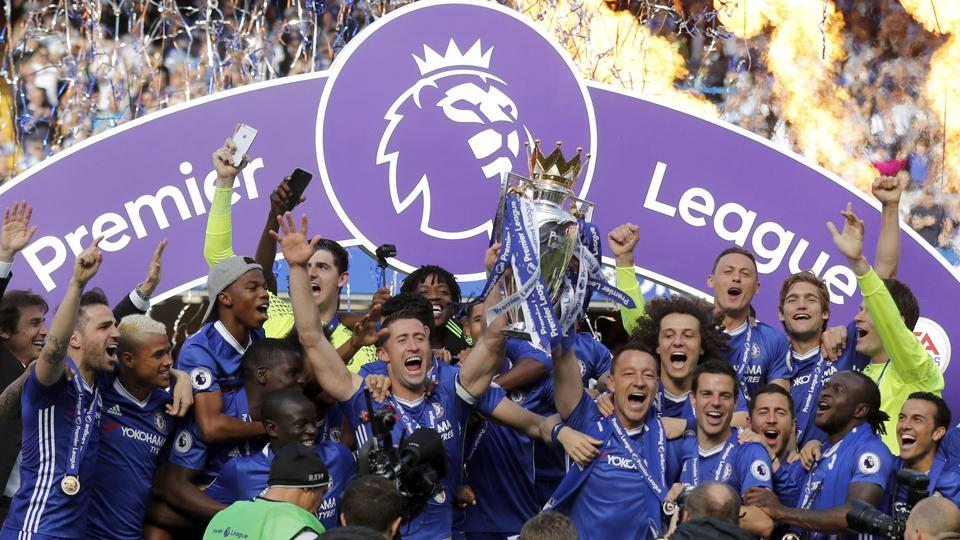 Chelsea captain John Terry (centre right) and Gary Cahill (centre left)  raise the Premier League trophy.