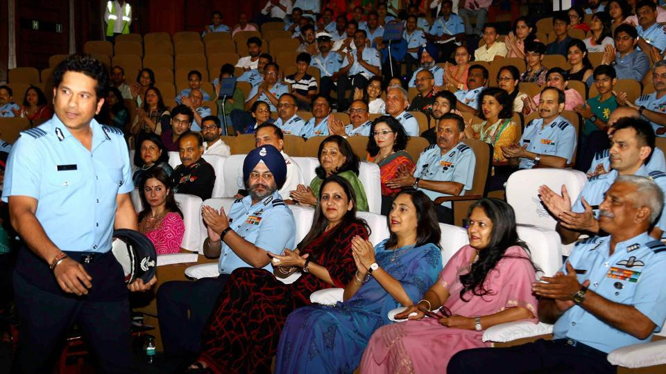 Sachin Tendulkar with armed forces personnel prior to the screening of the movie 'Sachin: A Billion Dreams' in New Delhi on Saturday.