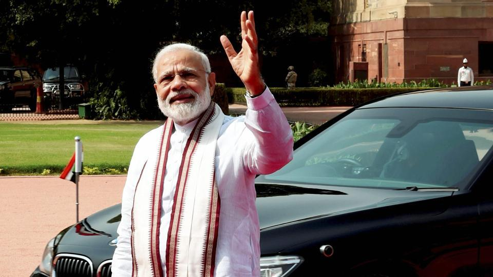 Prime Minister Narendra Modi waves to the media at a public engagement. The BJP, which has been on a winning spree in elections at both the state and local  government levels, has constantly relied on Modi's popularity to see it through.