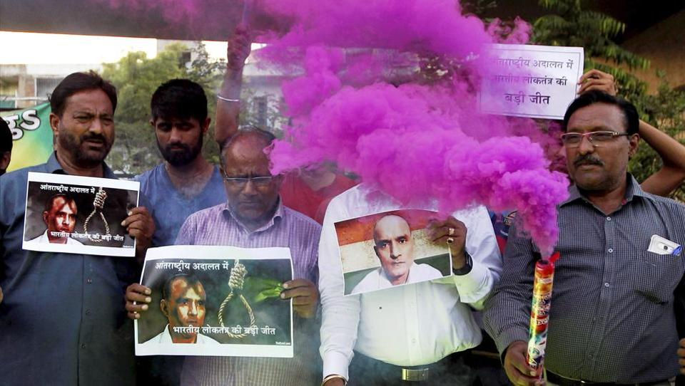 People celebrate with crackers the ICJ verdict on Kulbhushan Jadhav in Ahmedabad on Thursday.