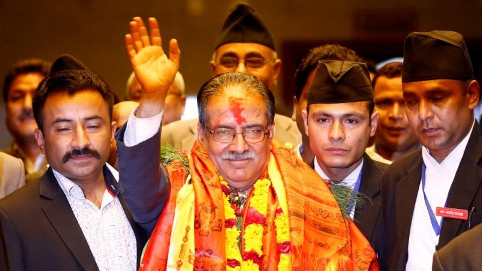 Nepal Prime Minister Pushpa Kamal Dahal, also known as Prachanda, waves towards the media after he was elected Nepal's 24th prime minister in 26 years, in Kathmandu on August 3, 2016.