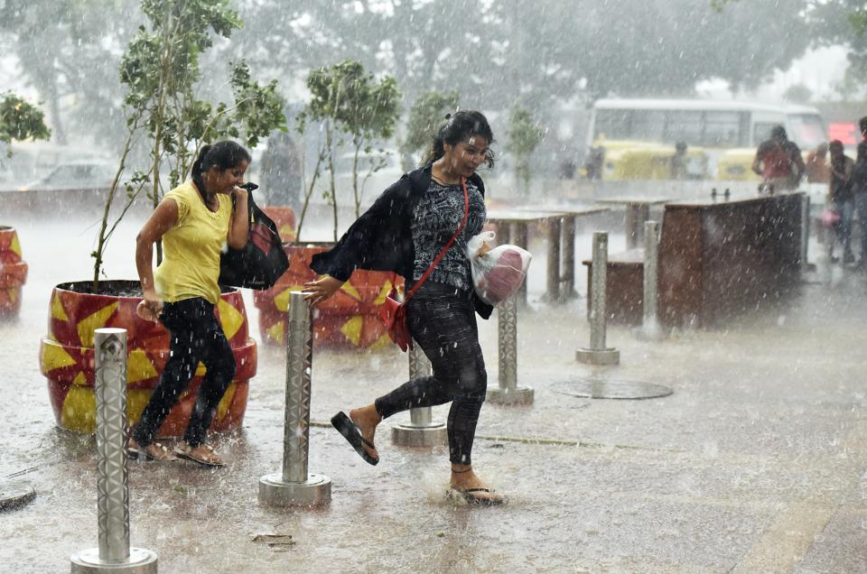 Image result for Rain lashes Delhi NCR, brings relief from heat, The people of Delhi NCR