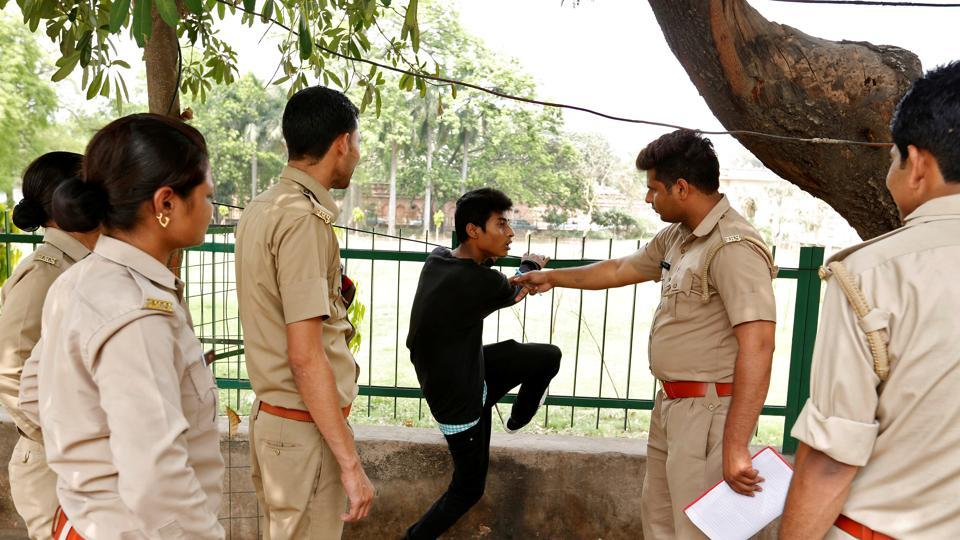 An anti-Romeo squad questions a youth following regulations imposed by Uttar Pradesh chief minister Yogi Adityanath, in Lucknow, on April 6, 2017.