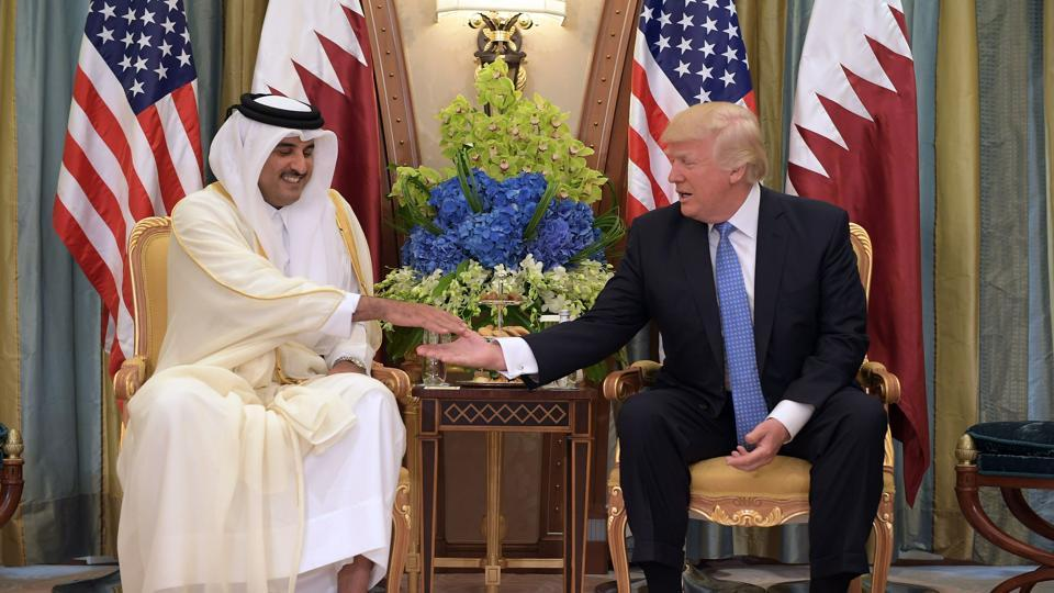 US President Donald Trump  and Qatar's Emir Sheikh Tamim Bin Hamad Al-Thani take part in a bilateral meeting at a hotel in Riyadh on Sunday.