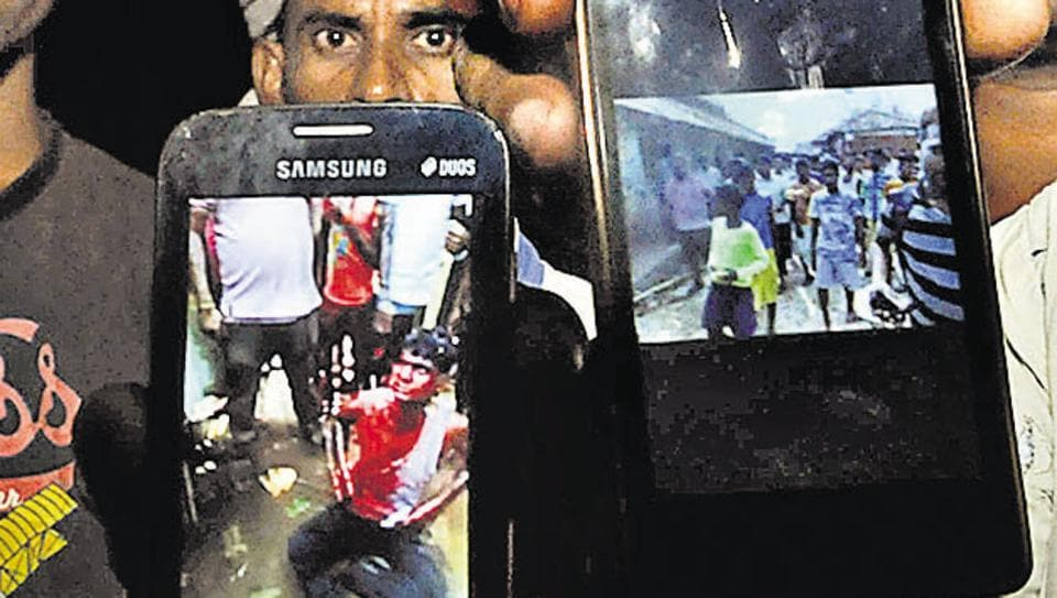Villagers of Haldipokhar showing videos of lynching gone viral at a late night villagers meeting in East Singhbhum on May 20.