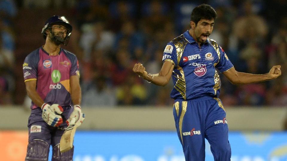 Mumbai Indians (MI)pacer Jasprit Bumrah (R) celebrates after the dismissal of Rising Pune Supergiant (RPS)batsman Rahul Tripathi (L) during the 2017 Indian Premier League (IPL) final at the Rajiv Gandhi International Cricket Stadium in Hyderabad on Sunday.