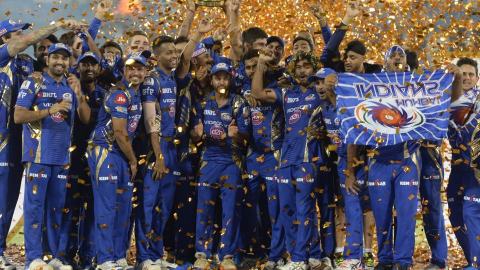 Mumbai Indians players hold the trophy as they celebrate their victory against Rising Pune Supergiant after the 2017 IPL Twenty20 final cricket match at the Rajiv Gandhi International Cricket Stadium in Hyderabad on May 21.