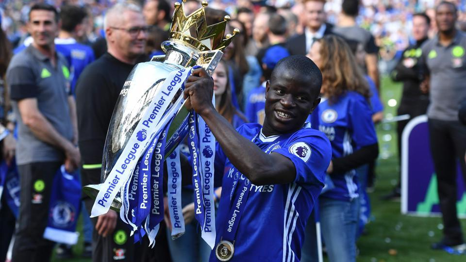 Chelsea's French midfielder N'Golo Kante poses with the Premier League trophy. Kante, who arrived from Leicester City this season, has been one of Chelsea's best performers this season. (AFP)