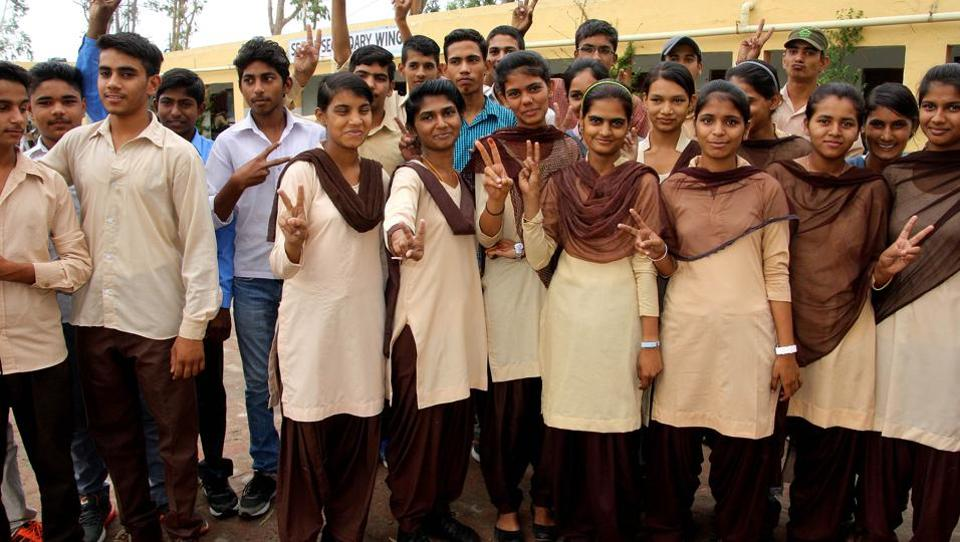 Students celebrating their result in Rohtak on Monday.