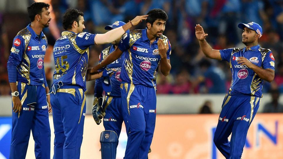 Mumbai Indians Jasprit Bumrah with team mates celebrate the wicket of MS Dhoni. (PTI)