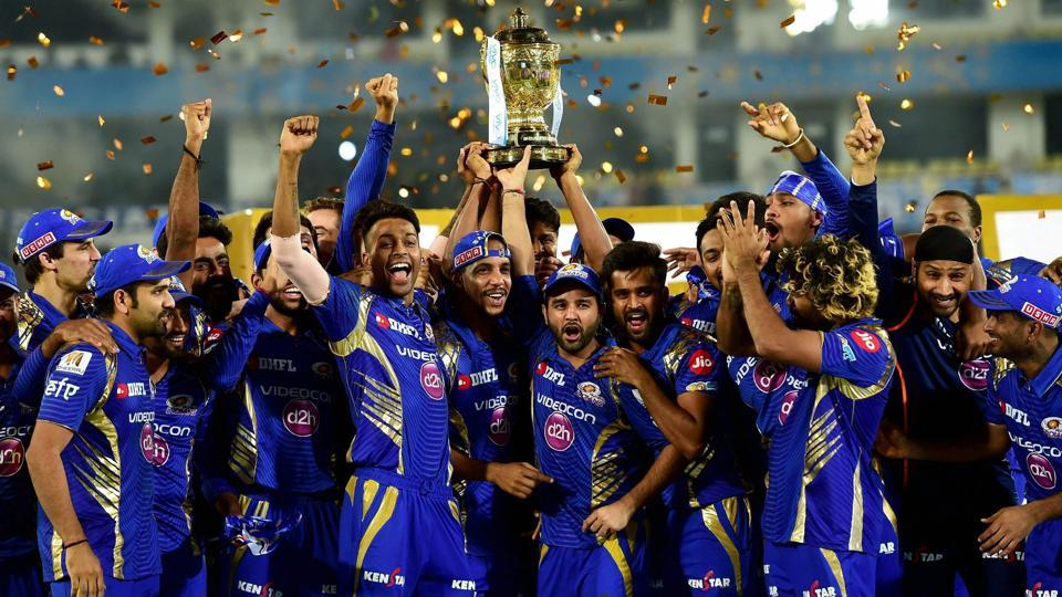 Mumbai Indians players with the IPL 2017 trophy after they defeated Rising Pune Supergiants by 1 run in the final. (PTI)