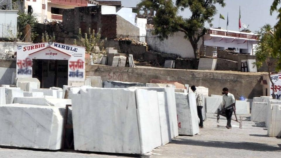 Labourers work at a marble unit in Rajasthan.