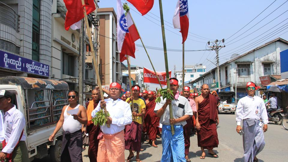 Hard-line Buddhists including monks walk through a street during a protest march, led by Rakhine State's dominant Arakan National Party, against the government's plan to give citizenship to some members of the persecuted Rohingya Muslim minority community in Sittwe, Rakhine state, Myanmar on March 19.