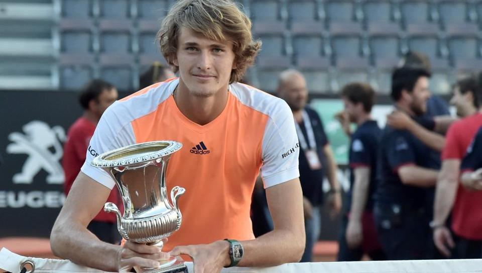 Alexander Zverev of Germany poses with the Italian Open trophy after beating Novak Djokovic on May 21 at the Foro Italico in Rome.