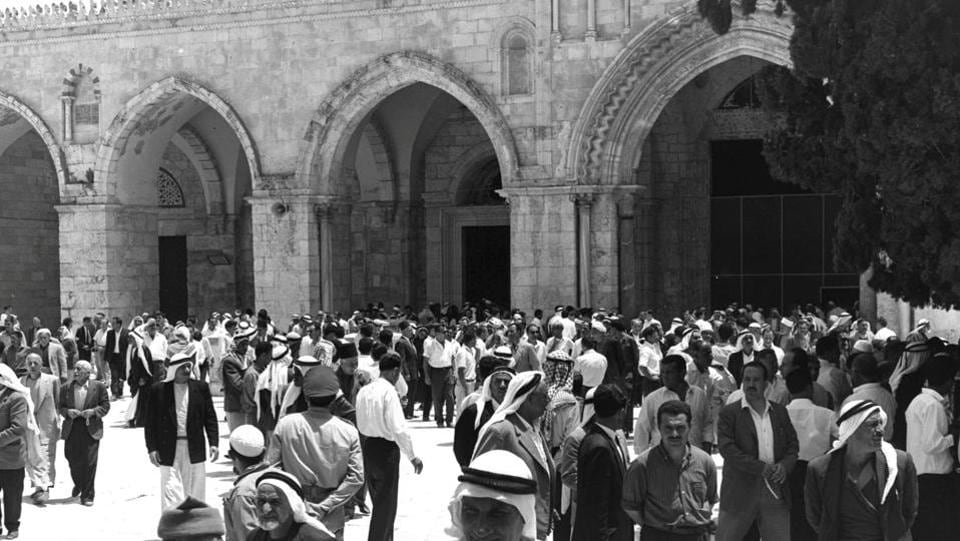 BEFORE:People stand in a plaza near al-Aqsa mosque during Friday prayers on the compound known to Muslims as Noble Sanctuary and to Jews as Temple Mount. (REUTERS)