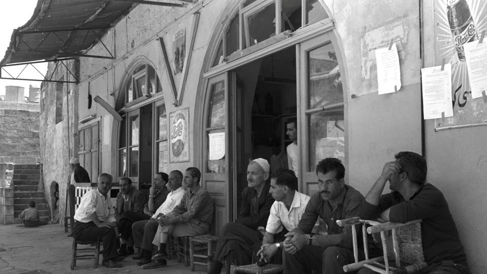 BEFORE: Men sit at a sidewalk cafe in Jerusalem's Old City.  For Palestinians, East Jerusalem is a symbol of their national struggle and home to Islam's third most sacred site, the al-Aqsa mosque, and the nearby glittering Dome of the Rock. (REUTERS)