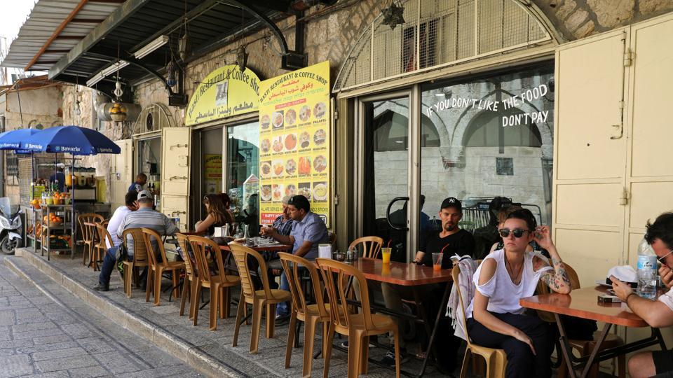 AFTER: People sit at a sidewalk cafe in Jerusalem's Old City. The Palestinians want the eastern part of the city to be the capital of their future state, alongside the West Bank and Gaza. (Ammar Awad  / REUTERS)